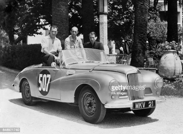 Stirling Moss John Cutts and John Fitch pose in the car they will be using in the International Alpine Rally which begins in Marseilles They are...