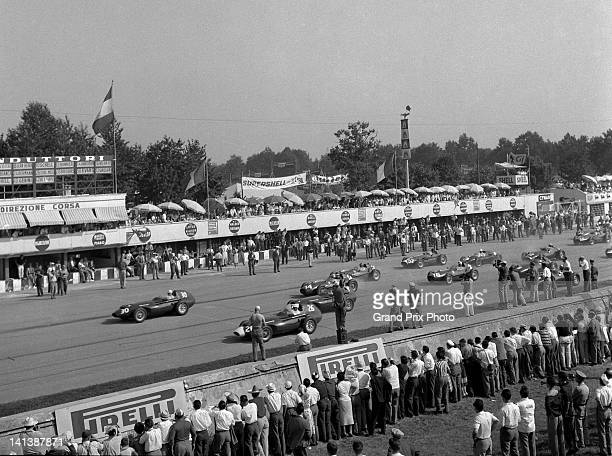 Stirling Moss of Great Britain driver of the Vandervell Products Ltd Vanwall Straight4 leads his team mates Stuart LewisEvans and Tony Brooks at the...