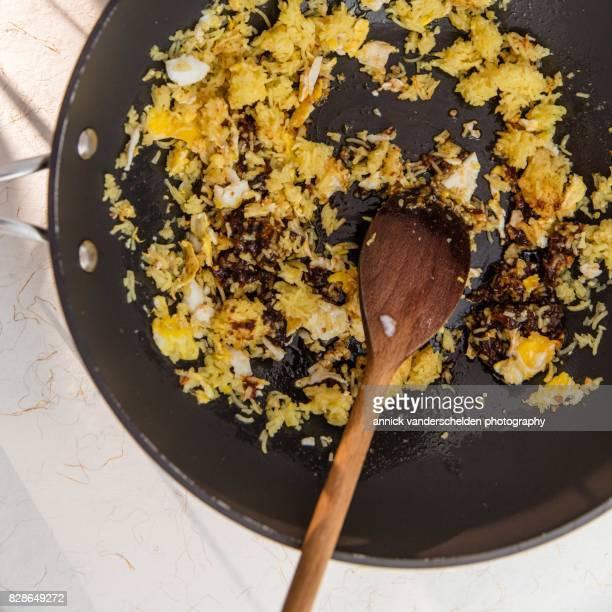 Stirred ingredients Indonesian nasi goreng recipe.