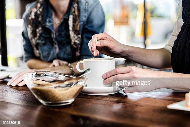 Stirring Sugar into a Cup of Coffee
