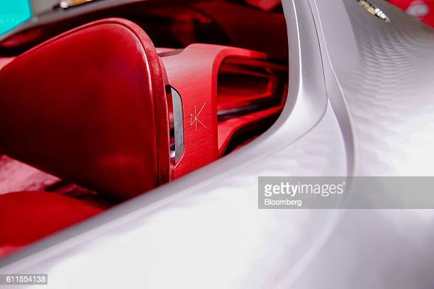 Stitching detail sits on a red leather seat headrest of the new Renault Trezor concept automobile produced by Renault SA during the second press day...