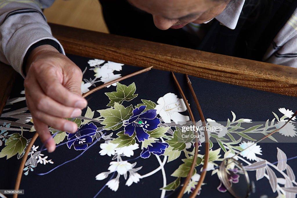 Stitching master Hitoshi Nakano works on a kimono during a stage of its production process at the Sensyo Ichikawa kimono workshop on April 26 2016 in...