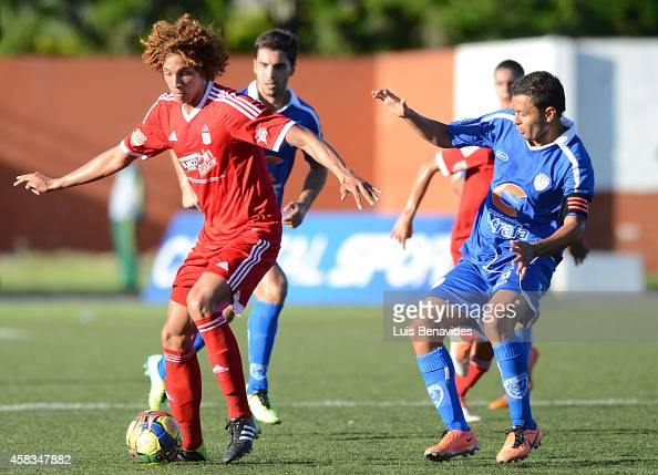 Stiven Tapiero of America de America de Cali is challenged by Mauricio Restrepo de Rionegro during a match between Rionegro a America de Cali as part...