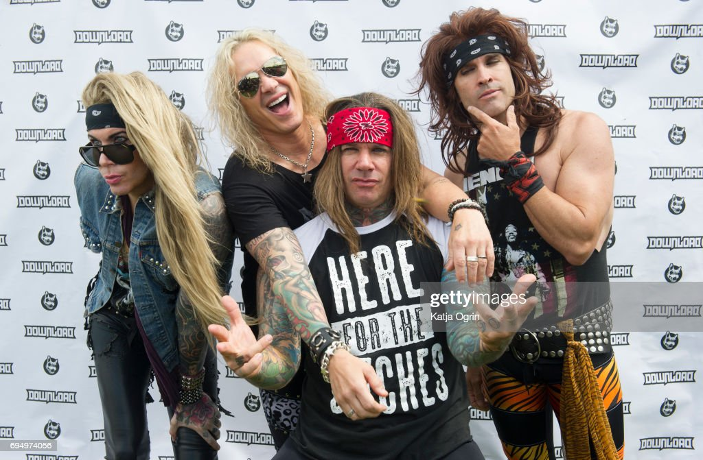 Stix Zadina, Michael Starr, Satchel and Lexxi Foxx of Steel Panther posing backstage on Day 3 of Download Festival at Donington Park on June 11, 2017 in Castle Donington, UK.