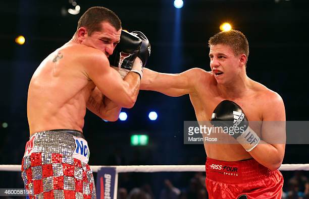 Stjepan Bozic of Croatia and Tyron Zeuge of Germany exchange punches during their IBF international super middleweight championship title fight at...