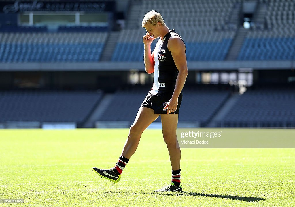 St.Kilda Saints captain Nick Riewoldt talks on the phone to a radio station during the AFL Captains media Day at Etihad Stadium on March 19, 2013 in Melbourne, Australia.