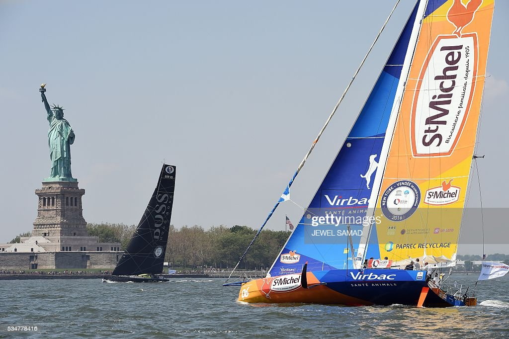 StMichale-Virbac's French skipper Jean-Pierre Dick and Hugo Boss's Alex Thomson sail past the Statue of Liberty on Hudson River during a charity race ahead of the New York-Vendee Race, on May 27, 2016 in New York. / AFP / Jewel SAMAD