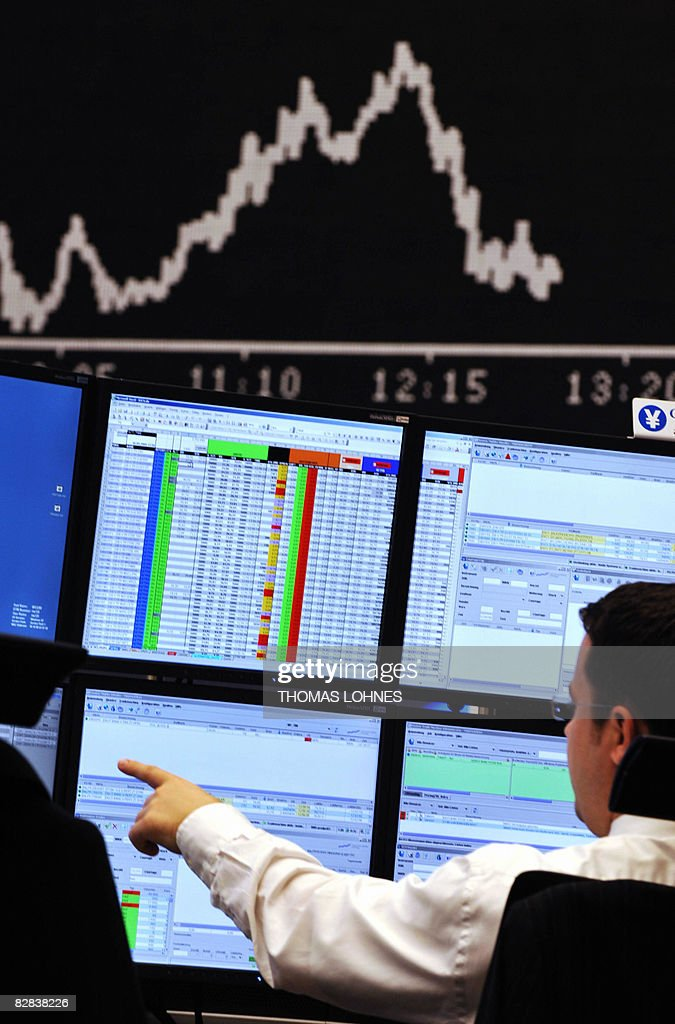 A stock broker points at his screen at Frankfurt's stock exchange on September 16 as the blue chip DAX 30 was down over three percent at 1300 GMT...