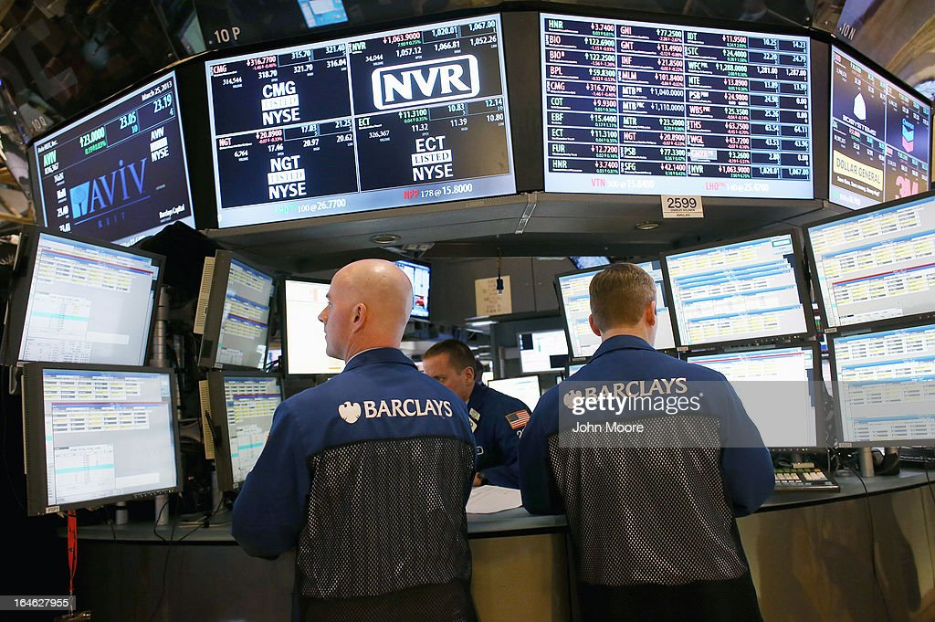 Stock brokers work the floor of the New York Stock Exchange on Wall Street on March 25, 2013 in New York City. The Dow Jones Industrial Average closed down 64 points Monday amid renewed worries about Cyprus.