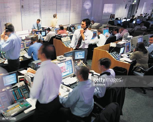 Stock brokers working at stock exchange