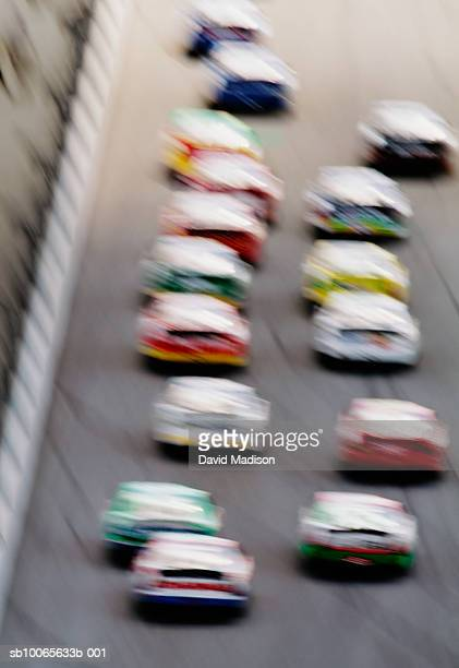 Stock cars on race track, blurred motion