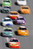 Stock cars on straight-away, elevated view (blurred motion)