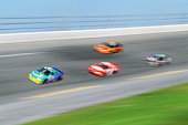 Stock cars racing around track (blurred motion, Digital Enhancement)