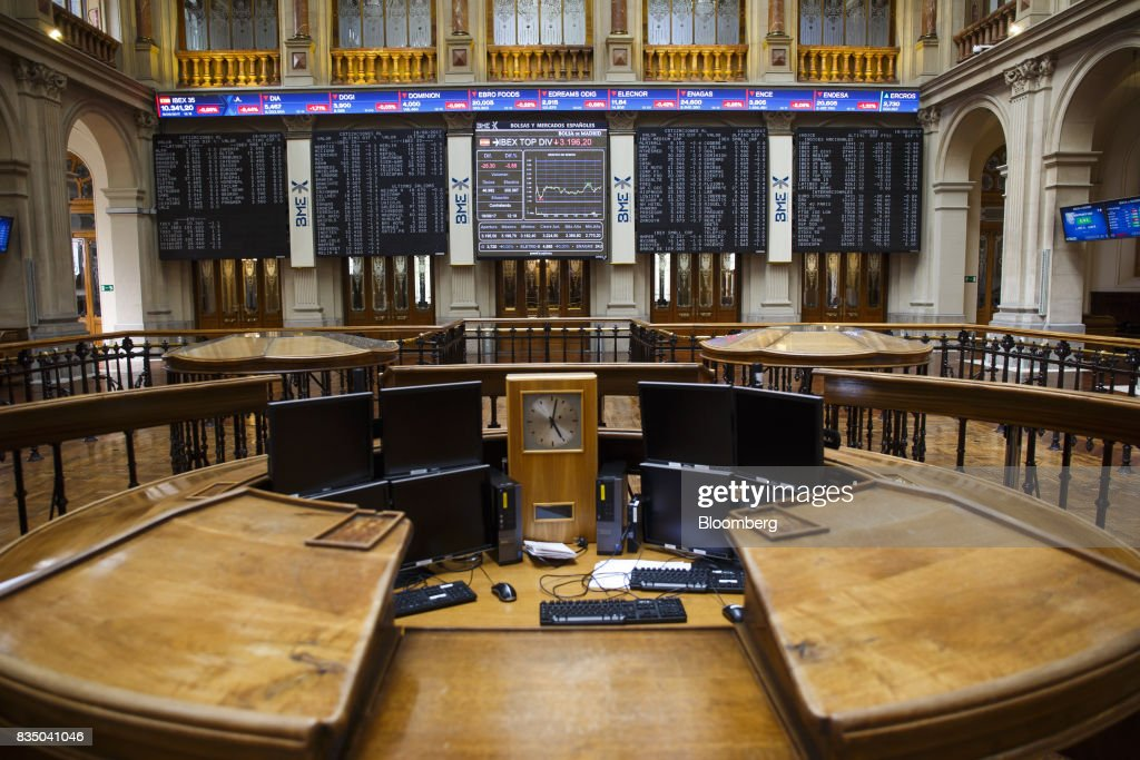 A stock index curve sits in the center of an electronic panel showing stock price information inside the Madrid stock exchange, also known as Bolsas y Mercados Espanoles, the day after the Barcelona terror attack in Madrid, Spain, on Friday, Aug. 18, 2017. Terrorists behind the Barcelona attack had planned a devastating assault with explosives and may have rammed pedestrians with vehicles after their initial plan failed, the police chief heading the investigation said on Friday. Photographer: Angel Navarrete/Bloomberg via Getty Images