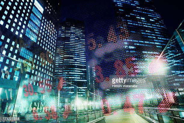 Stock index with cityscape at dusk
