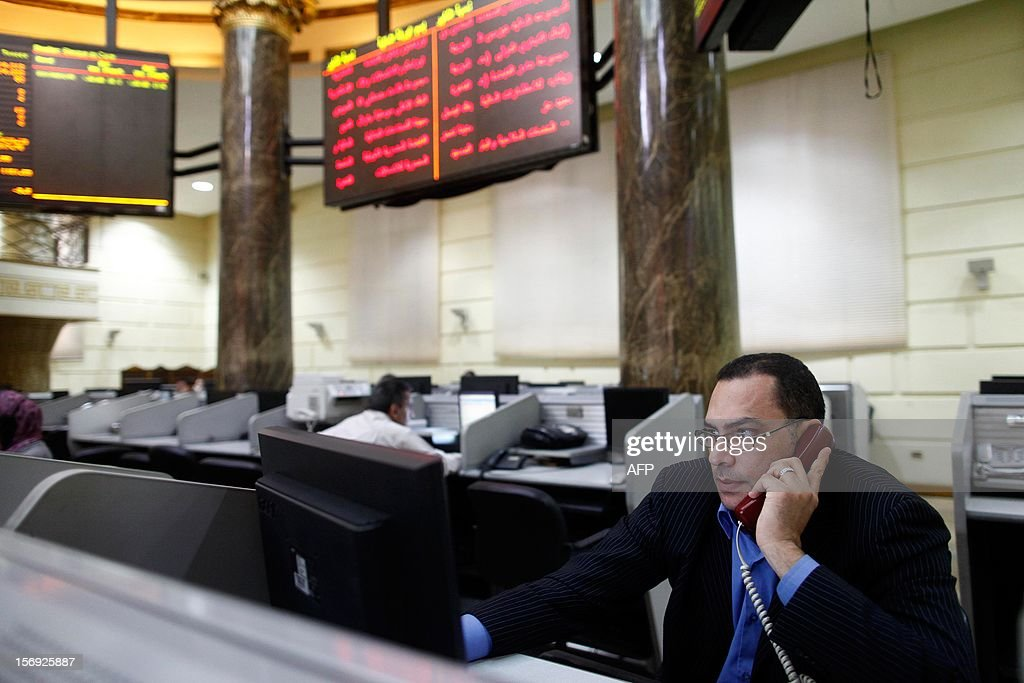 A stock market broker is on the phone at the Egyptian Stock Market on November 25, 2012 in Cairo. Share prices on the Egypt Exchange declined almost 9.5 percent by midday today, after President Mohamed Morsi assumed sweeping powers that sparked clashes and polarised the country's politics. The main EGX-30 index shed 9.49 percent to reach 4,923.19 points, according to the Egyptian Exchange.