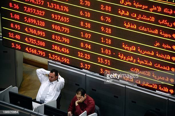 Stock market brokers gestures during trading at the Egyptian Stock Market on November 25 2012 in Cairo Share prices on the Egypt Exchange declined...