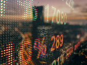 Stock market data chart display ticker board concept