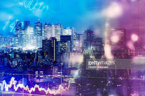 Stock market graph with cityscape at dusk