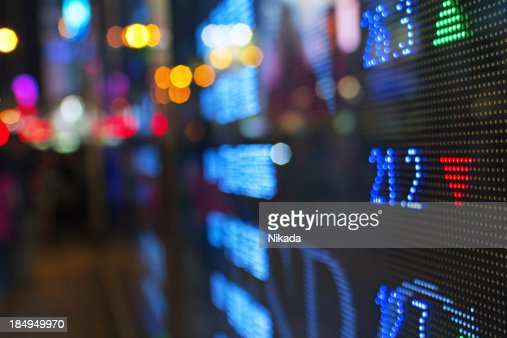 Stock market screen fading into blur
