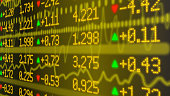 Stock market ticker wall in yellow with various numbers and graphs