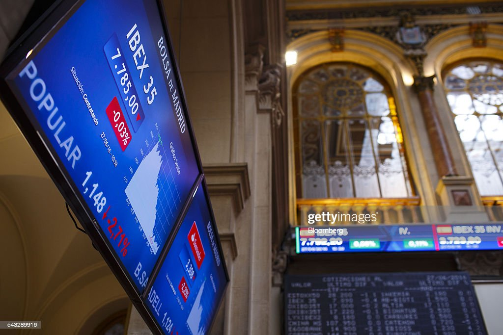 Stock performance information for the Ibex 35 index sits displayed on electronic screens at the Madrid stock exchange, also known as Bolsas y Mercados Espanoles, in Madrid, Spain, on Monday, June 27, 2016. Spanish government bonds jumped, pushing the yield down by the most in eight months, after Acting Prime Minister Mariano Rajoy defied opinion polls to consolidate his position in the country's general election after Brexit rocked the world's financial markets last week. Photographer: Angel Navarrete/Bloomberg via Getty Images