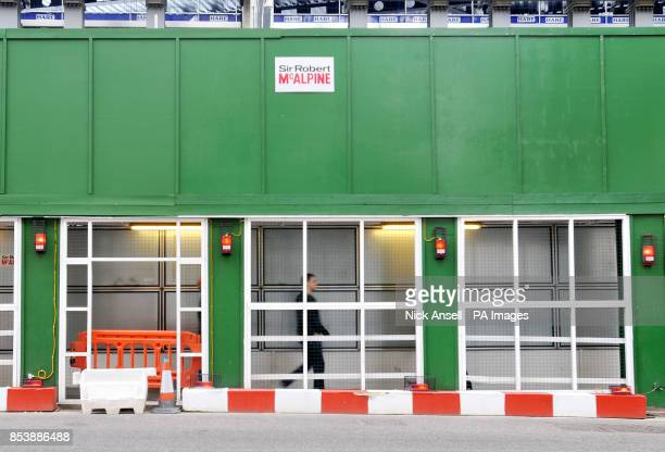 Stock photo of a man walking in the safety tunnel footpath at the construction site of the new offices of Bloomberg situated between Mansion House...