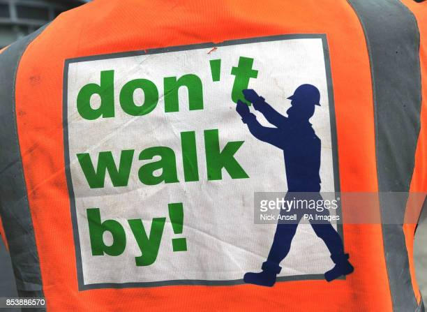Stock photo of a safety information sign on the back of a Hivis jacket of a worker at the construction site of the new offices and station entrance...