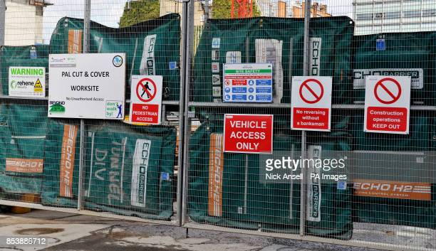 Stock photo of construction safety information signs at the site entrance of the new offices station entrance and shops at Victoria Station in...