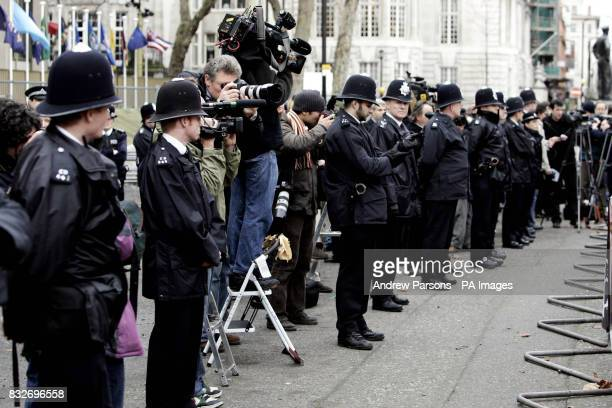 Stock photo of police officers making the press work behind the police line at the US Embassy where protesters after there marking the fifth...