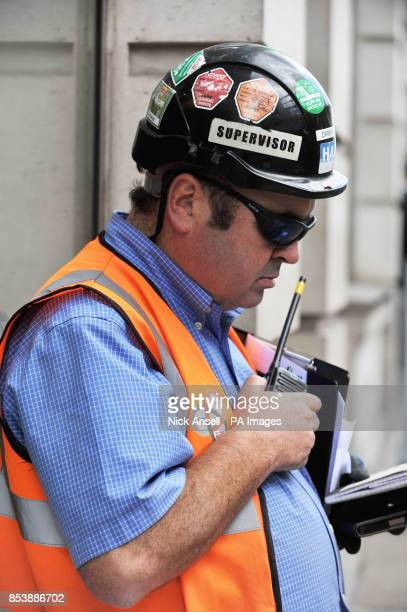 Stock photo of safety stickers on the hard hat of a construction worker at the site of the new offices of Bloomberg situated between Mansion House...