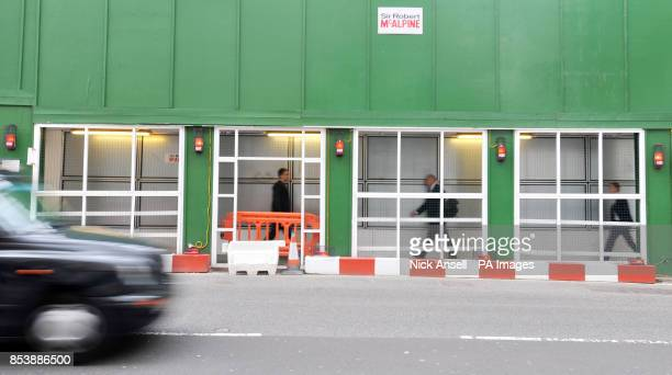 Stock photo people walking in the safety tunnel footpath at the construction site of the new offices of Bloomberg situated between Mansion House and...