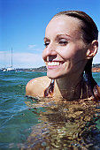 A stock photograph of a beautiful young woman's portrait in the water.