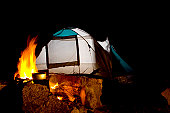 A stock photograph of a tent in a camping ground.