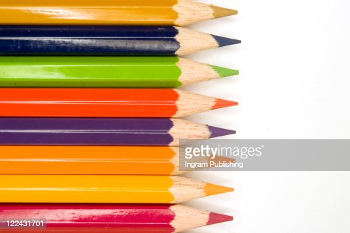 Stock photograph of brightly colored pencils forming aásymmetric pattern. : Stock Photo