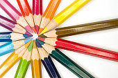 Stock photograph of brightly colored pencils forming aásymmetric pattern.