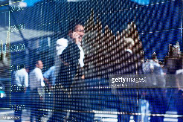 stock price chart and business men
