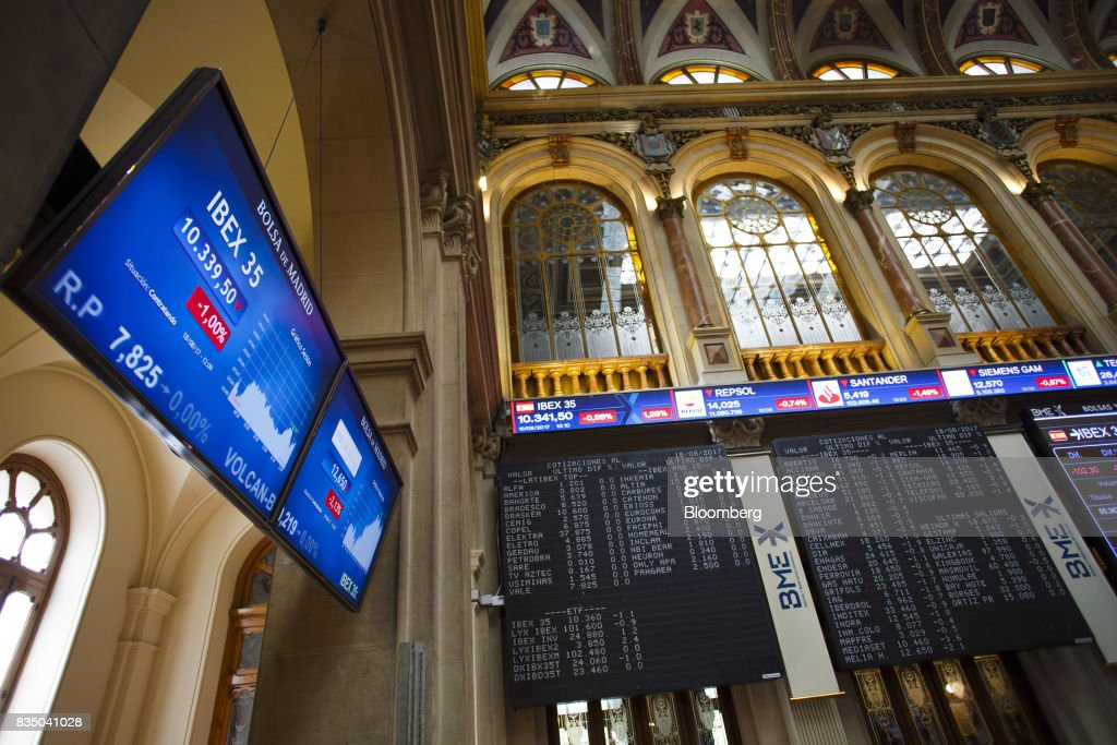 Stock price information sits on electronic screens inside the Madrid stock exchange, also known as Bolsas y Mercados Espanoles, the day after the Barcelona terror attack in Madrid, Spain, on Friday, Aug. 18, 2017. Terrorists behind the Barcelona attack had planned a devastating assault with explosives and may have rammed pedestrians with vehicles after their initial plan failed, the police chief heading the investigation said on Friday. Photographer: Angel Navarrete/Bloomberg via Getty Images