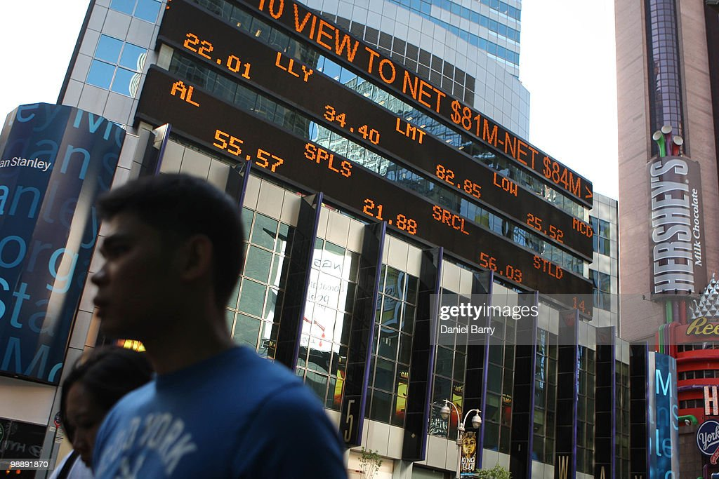 Stock prices are displayed on a news ticker in Times Square May 6, 2010 in New York City. The Dow Jones industrials plunged nearly 1,000 points before ending the day down at 347.