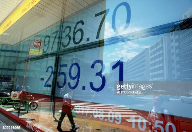 A stock quotation board displays the Nikkei 225 key index of the Tokyo Stock Exchange in front of a securities company in Tokyo on August 9 2017...