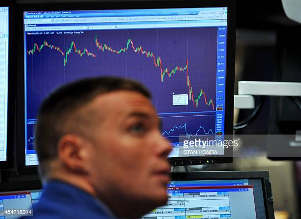 A stock specialist watches prices on the floor of the New York Stock Exchange on August 4 2011 The Dow Jones Industrial Average plunged 43 percent...