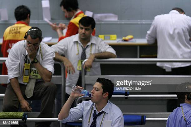 A stock trader drinks water as he negotiates in the iBovespa future index pit prior to the morning closing time at the Mercantile Futures Exchange in...