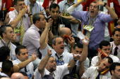 Stock traders gesture while negotiating in the iBovespa future index pit during the morning session at the Mercantile and Futures Exchange in Sao...