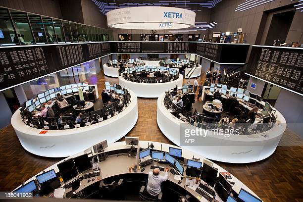 Stock traders work at the Deutsche Boerse in the central German city of Frankfurt am Main after a press conference on February 1 2012 The EU...