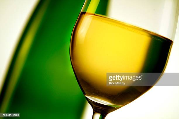 Stock wine photo of a glass of White Wine with the bottle