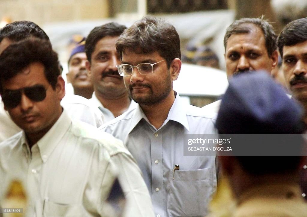 Stockbroker Ketan Parekh chairman of Madhavpura Mercantile Cooperative Bank is led to a session court by Central Bureau of Investigation agents 09...
