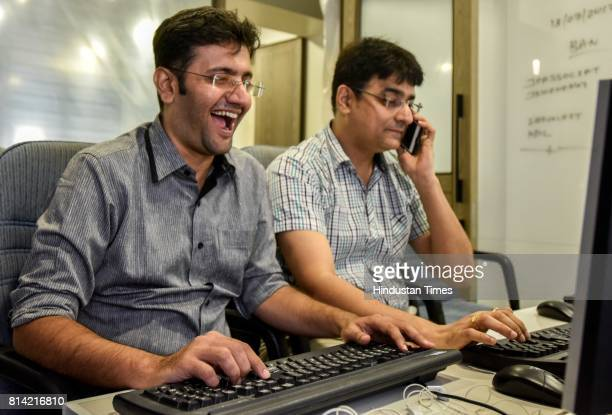A stockbroker trades shares on a terminal as the benchmark share index SENSEX crosses 32000 points at a brokerage house on July 13 2017 in Mumbai...