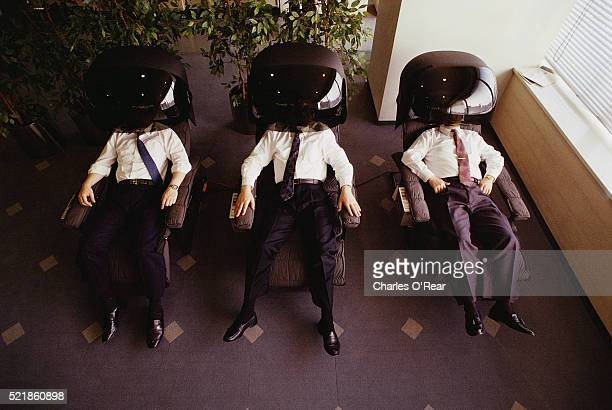 Stockbrokers Relaxing in Vibrating Chairs