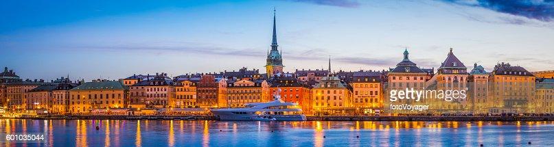 Stockholm Gamla Stan waterfront hotels spires illuminated sunset panorama Sweden