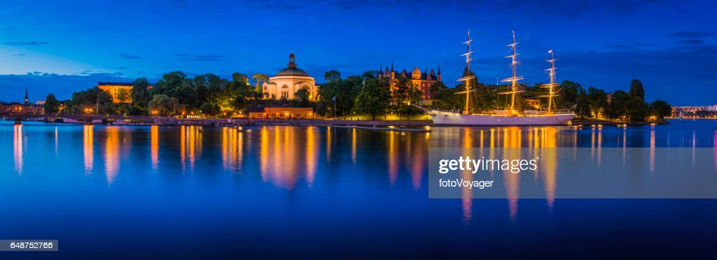 Sailing Ship Is In Foreground Of Skeppsholmen Islands At Evening ...